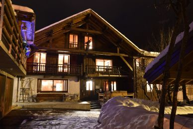 Ardoisiers Exterior front of chalet at night