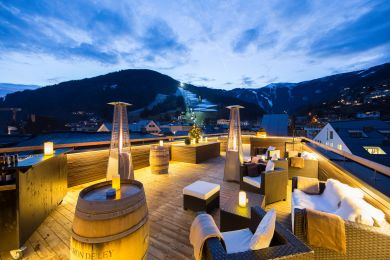 A panoramic view from Hotel Heitzmann rooftop bar in the winter with snow on the mountains