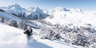 Skier above the resort of Les Deux Alpes in France
