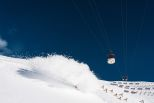 Cable car and powder splash in Les Deux Alpes