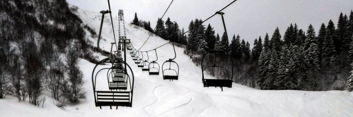 An empty chairlift above Les Gets during winter