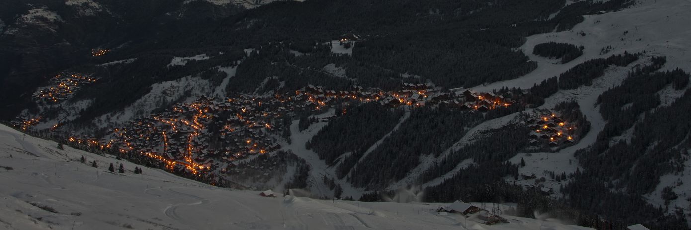 Meribel By Night with the lights and the mountains in the dark
