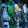 Skis and Snowboards standing outdoor