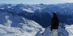 A skier or snowboarder admiring the Alpine view