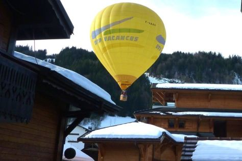 Hot air balloon over the chalet rooftops in Morzine ski resort