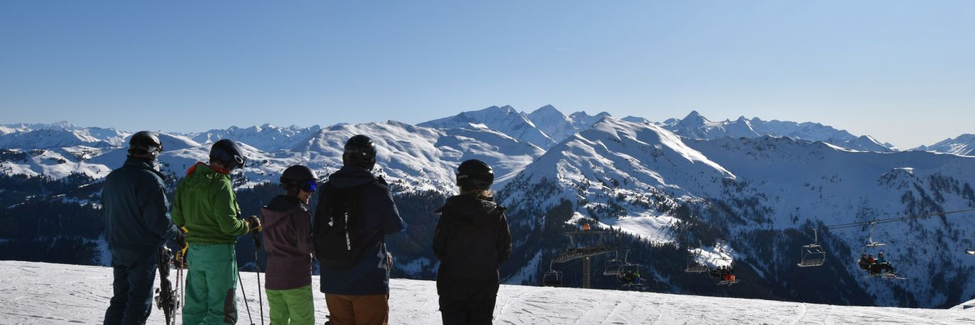 Skiers checking out the Solo Ski Holidays guide