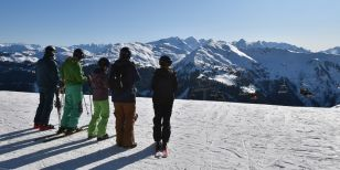 Skiers checking out the Guide to Solo Ski Holidays