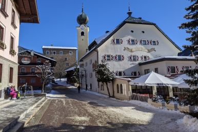 Hotel Post in the town of SaalBach on a sunny day with snow on the ground