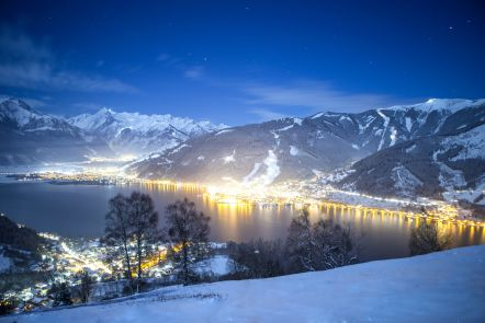A night time view of the lake with Zell Am See resort