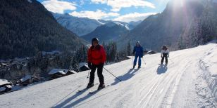 Skiers learning to ski on a beginners ski holiday