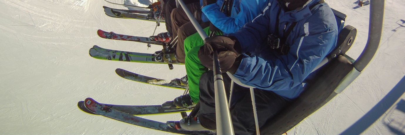 Guided skiers on a chairlift