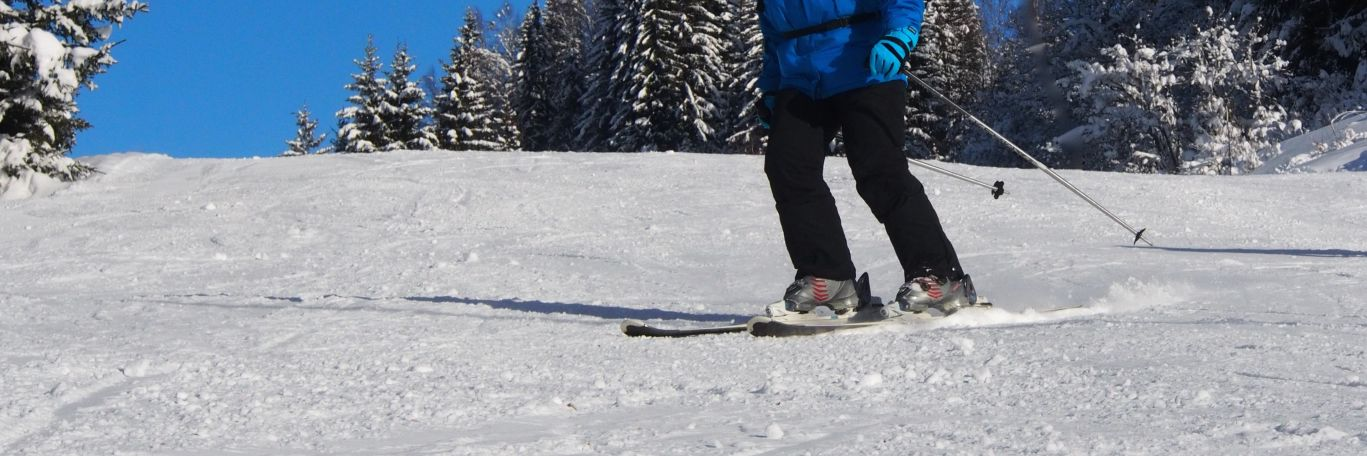 An adult lady skiing in Les Gets, a great place for our adult only ski holidays